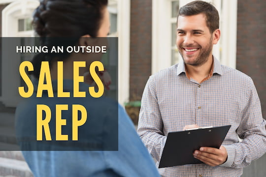 Outside Salesperson with a clipboard talking to a possible client - Hiring an Outside Sales Rep