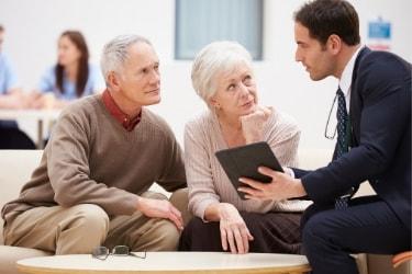 Salesman talking to an elderly couple