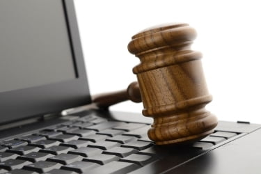 Gavel on top of a laptop