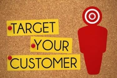 """""""Target your customer"""" with a target on a human shaped paper"""