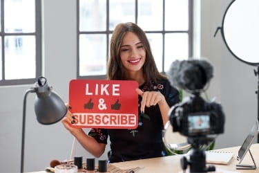 Influencer recording herself asking for likes & subscribes