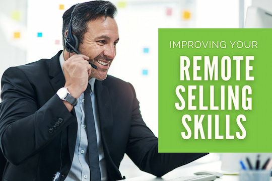 Man with a headset doing sales remotely - Improving Your Remote Selling Skills