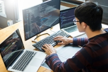 Software developer working in front of a computer