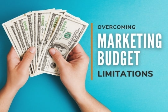 Hands with money bills - Overcoming Marketing Budget Limitations