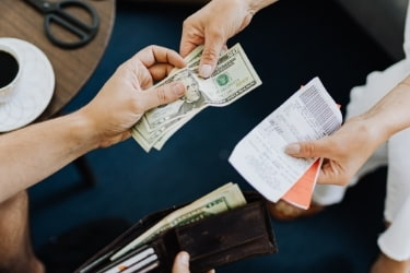 Person paying in cash
