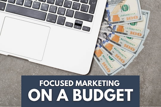 Laptop and money - Focused Marketing on a Budget