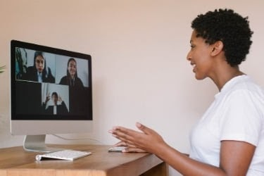 Woman being interviewed remotely