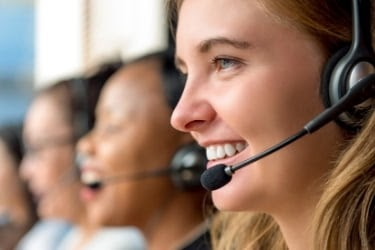 Woman with a headset doing customer service