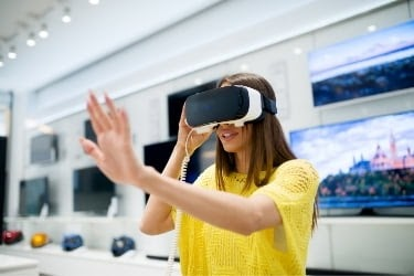 Woman testing a VR device at the store