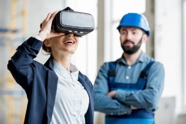 Woman visualizing the building with a VR device