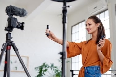 Seller filming herself with product