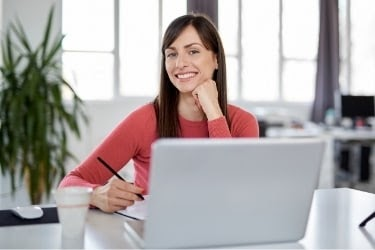 Woman sitting in front of her laptop working