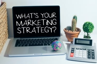 """Laptop with the text """"What's your marketing strategy?"""""""