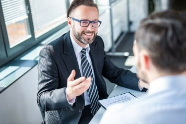Happy business man talking to his client