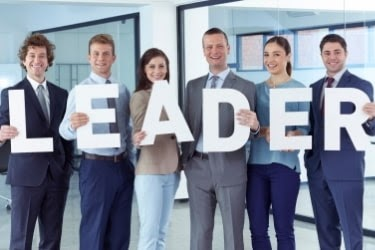 """Company employees holding the word """"Leader"""""""