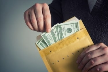 Hands with an envelope with monetary bonus