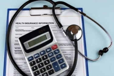 Health Insurance Information with a calculator and a stethoscope