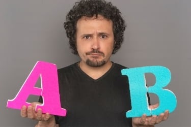 Man holding a letter A and B