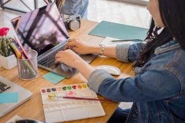 Graphic Designer using a laptop