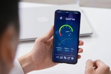 Man checking Speed test on mobile phone