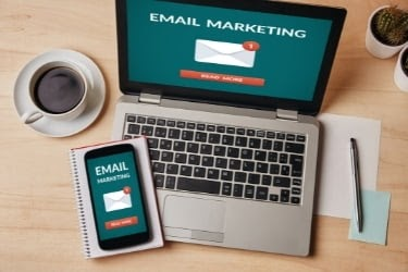 Laptop and Mobile with an Email Marketing screen