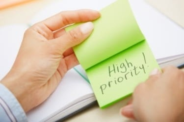 Sticky note that says High Priority!