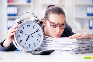Woman tired with a clock and a lot of work