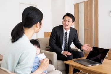 Man doing a sales presentation to a woman