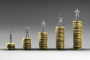 Sales Growing concept - People on top of coin piles