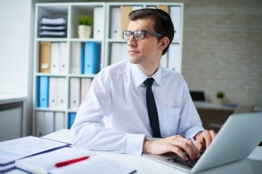 Man thinking about original content while writing a new blog
