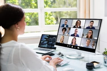 Woman working from home in a virtual meeting