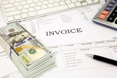 Invoice and a stack of cash