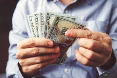 Man with cash in hands