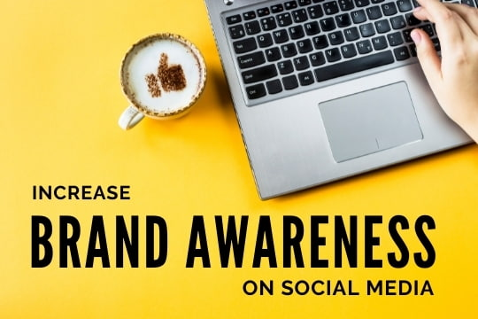 Increase Brand Awareness on Social Media - Coffee with a thumbs up icon next to a laptop