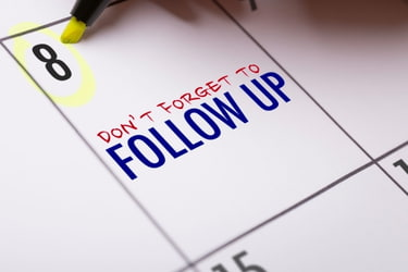 Calendar with the note: Don't Forget to Follow Up