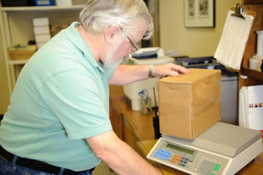 Worker weighing a box