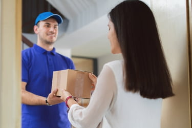 Man delivering a box to a woman