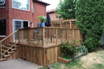 Simple backyard deck with railing
