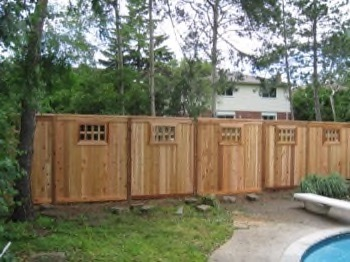 backyard wooden fence with port holes