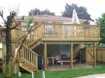 raised backyard deck with stairs down