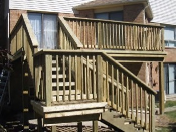 backyard deck with stairs going down