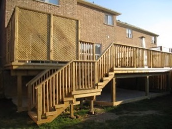 large backyard open deck with two levels of stairs
