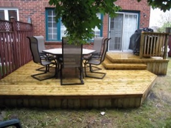 Simple low profile wooden deck with furniture