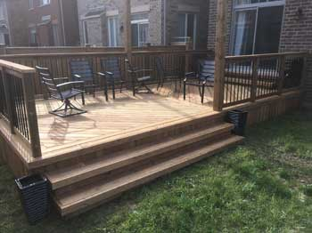 large low profile wooden deck with railing