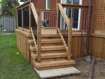 small wood deck with railing
