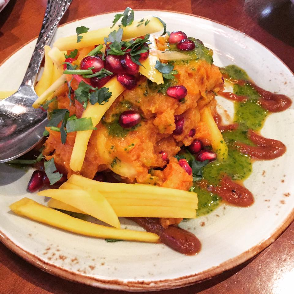 Sharkandi Chaat with sweet potato salad mixed with roasted cumin, chaat masala and garnished with mango