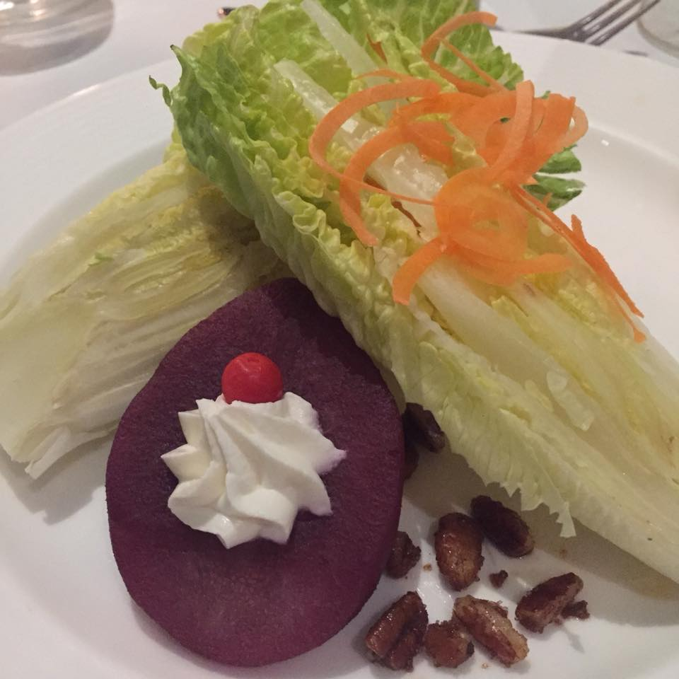 Hearts of romaine, merlot poached pear, whipped fromage blac, spiced peans, Peruvian pepper, white balsamic vinaigrette