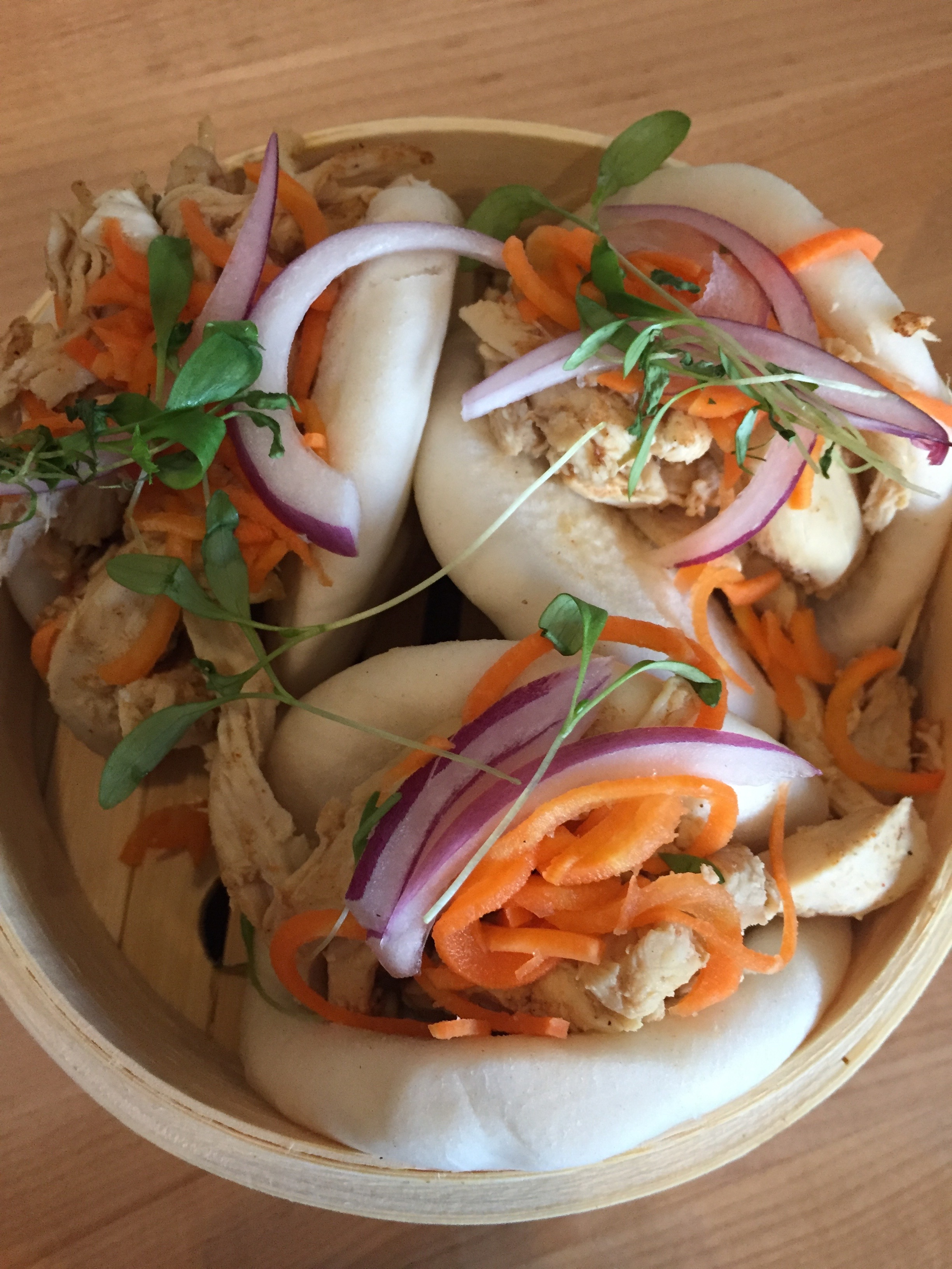 Chicken Bao Buns with braised chicken, pickled carrots, red onion, cilantro
