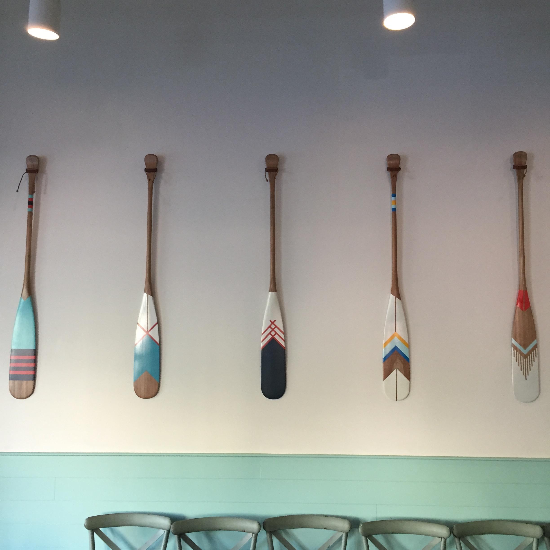 colorful boat oar wall decor
