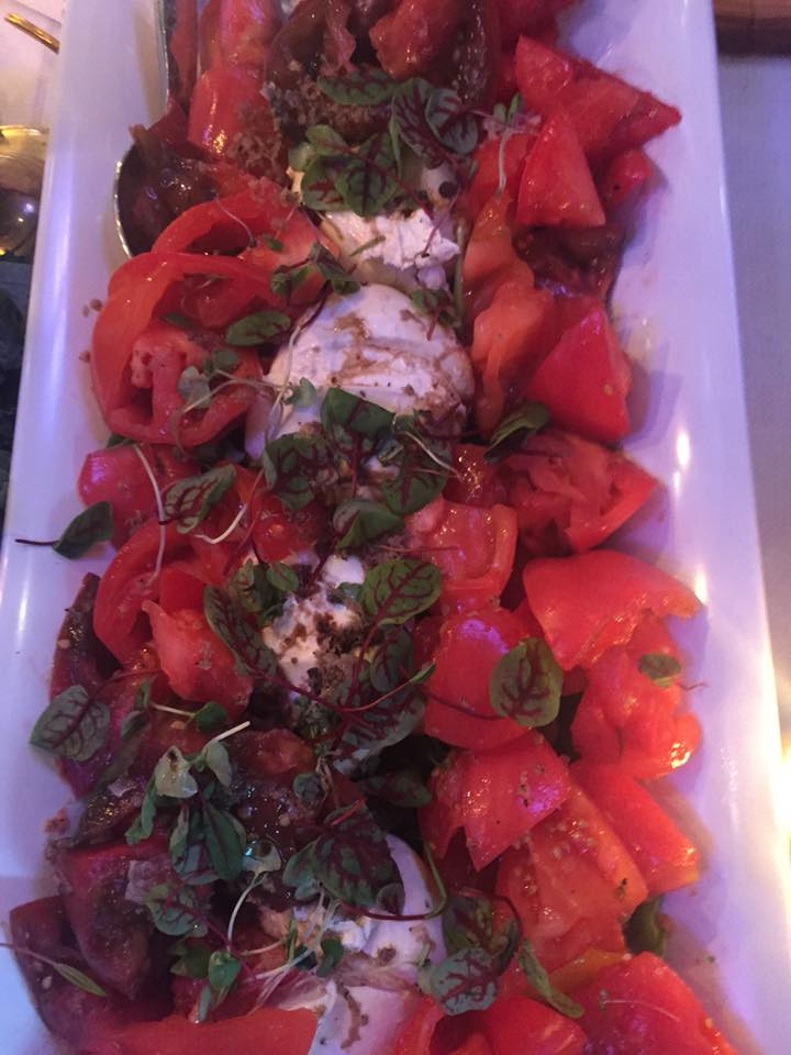 truffled burrata and heirloom tomato salad with Meyer lemon vinaigrette and shisho
